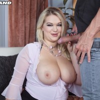 Huge-boobed light-haired Katrin smooches her boy buddy after taking his rock hard penis in hand