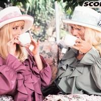 Chesty platinum-blonde Lisa Lipps and a mistress of a similar description share a lezzie kiss in garden