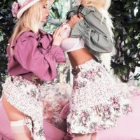 Chesty platinum-blonde Lisa Lipps and a mistress of a similar description share a lezzie kiss in garden