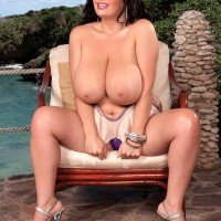 Big-boobed dark haired MILF Arianna Sinn clipping and munching her own hard nips outdoors