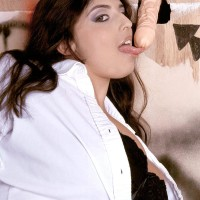 Huge-titted black-haired plumper Kerry Marie deep-throats junk via a gloryhole in wall