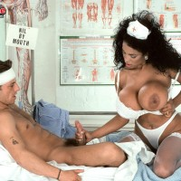 Bosomy ebony nurse Angelique tempts a masculine patient during upskirt action on a bed