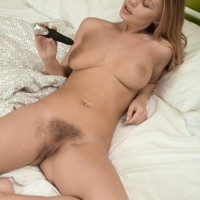 Bosomy Euro first timer Darina Nikitina dildoing unshaven gash while masturbating