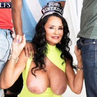 Huge-chested granny Rita Daniels sucks on giant white and black peckers for bday number 69