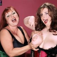 Bosomy aged lesbians Angela Milky and Cherry Brady play lesbian domination games in lingerie