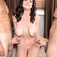 Big-boobed mature lady Karen Kougar tugs on two knobs after being caught masturbating