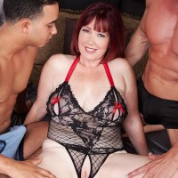 Huge-boobed red-haired MILF Heather Barron boinking TWO enormous dicks during MMF threeway