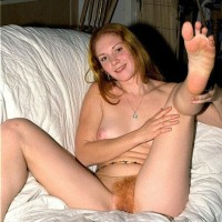 Caucasian first-timer puts her ginger fuckbox on show while downright naked by herself
