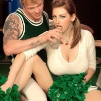 Cheerleader uniform wearing Christy Marks unsheathing immense funbags for tit fucking