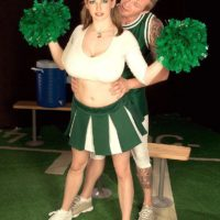 Cheerleader uniform wearing Christy Marks unsheathing immense funbags for tit fucking