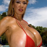 Big-boobed Japanese dame Minka models a pair bathing suits outdoors in close closeness to a pool