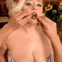 Chubby sandy-haired female Daphne Carter letting hefty breasts loose while munching food and delivering FELLATIO
