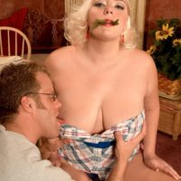Chubby platinum-blonde female Daphne Carter letting monster-sized fun bags free while munching food and giving oral pleasure