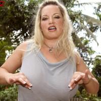 Plump sandy-haired MILF Rachel Love unsheathing cute funbags outdoors for nip eating