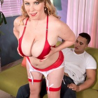 Chubby blond X-rated film starlet Desiree unsheathing immense funbags and delivering ORAL JOB in nylons