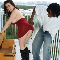 Plump dark-haired Daphne Rosen shows off her monster-sized bootie in ebony boots on blacony