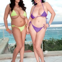 Chubby brown-haired Michelle Bond and girlfriend unleash monster-sized all natural juggs from bathing suits