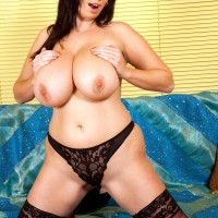 Chubby brown-haired MILF baring melons before inserting bang stick into cootchie in tights