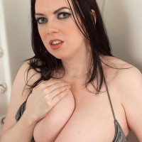 Chubby MILF Emily Cartwright pinches her hard nipples after uncovering hooters from a bikini