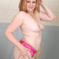 Plump older dame letting her titties fall loose from boulder-holder while doffing her clothes