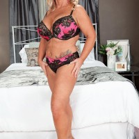 Plump over Fifty blonde MILF Zena Rey baring giant knockers from melon-holder while seducing man