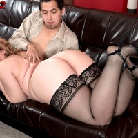 Chubby XXX film star Brandi Sparks slipping underwear over enormous butt in nylons and high heeled shoes