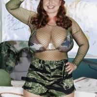Chubby redhead MILF Cherry Brady letting out massive hooters in military fatigues
