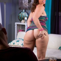 Thick dark-haired chick Peridot flashing hefty upskirt ass in g-string panties and stilettos