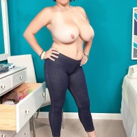 Plumper dark haired stunner Elaina Gregory uncovering hooters in jeans and high heeled shoes