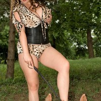 Thick Dominatrix Jana letting gigantic natural tits free outdoors in the park