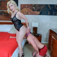 Clothed blond Inga Victoria has her ass snuffled by her girlfriend's slave