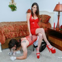Fully-clothed dark haired Authoritative type Dava Foxx teaching crossdressing sissy maid with crop