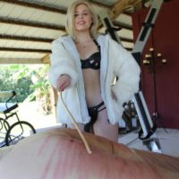 Clothed dominant Isobel Raven and girlfriends cane bound boy on limit bondage table