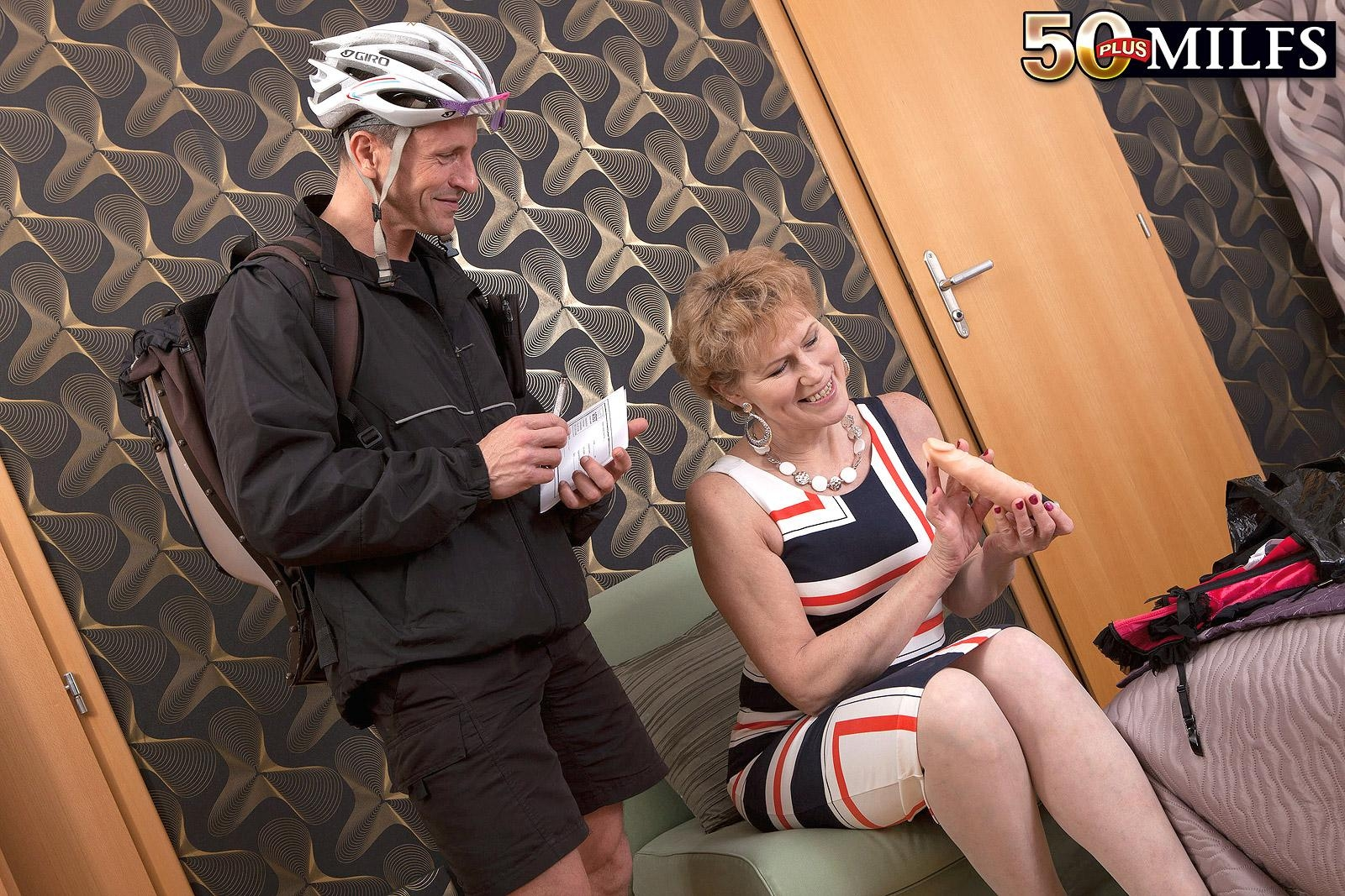 Clothed older woman Georgina seducing pedal bike courier with a blow job in stockings