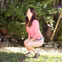 Dressed teenage Jennifer Matthews displaying upskirt panties outdoors