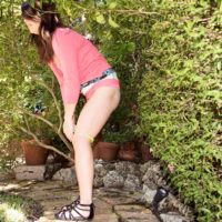 Dressed teenage Jennifer Matthews displaying upskirt panties outdoors