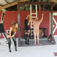 Dressed dolls Michelle and Lacy plus a mistress dominate nude dudes outdoors