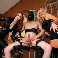 Fully-clothed nymphs Zoey and Kendra refuse a hooded male slave from having an climax