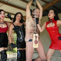 Wicked females with dark hair torture a masculine submissive fully clothed in spandex and lengthy boots