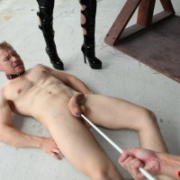 Brutish women Kimmy and Alexia torture collared masculine slave with electroshock device