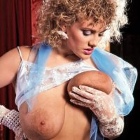 Curly platinum-blonde Suzanne Brecht unveils her enormous boobs in lace lingerie and gloves