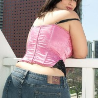 Curvaceous brown-haired MILF London Andrews releasing knockers for nip tonguing in jeans