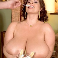 Curvaceous chick Maria Moore flaunting big fun bags while licking food and delivering BLOW JOB