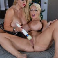 Curvaceous mature light-haired Karen Fisher and her lesbian gf break out a sex toy on a bed