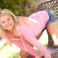 Ultra-cute blonde teen Mindy unsheathes her hard boobs and g-string wearing bum on a patio