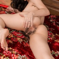 Brunette amateur Luna O shows her unshaven pits and full thicket at Christmas