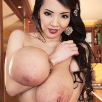Black-haired Chinese solo chick Hitomi uncovering huge knockers in hose and undies
