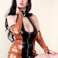Dark-haired babe Sha Rizel demonstrating no panty upskirt in latex dress and high-heels