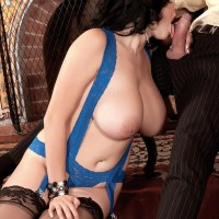 Dark haired solo girl Shione Cooper licking junk while displaying cute juggs in stockings