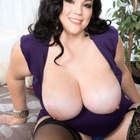 Black-haired BIG BEAUTIFUL WOMAN Charlotte Angel sets her hefty titties free of sundress and melon-holder
